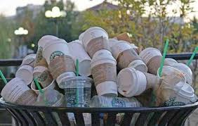 Paper cups in trash can