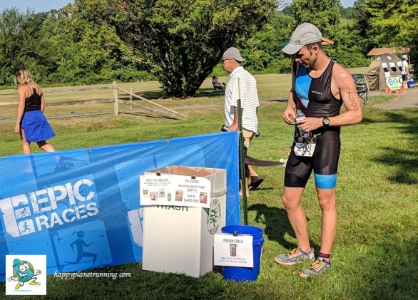 Ann Arbor Triathlon 2018 - Runner reading signs on finish line bins