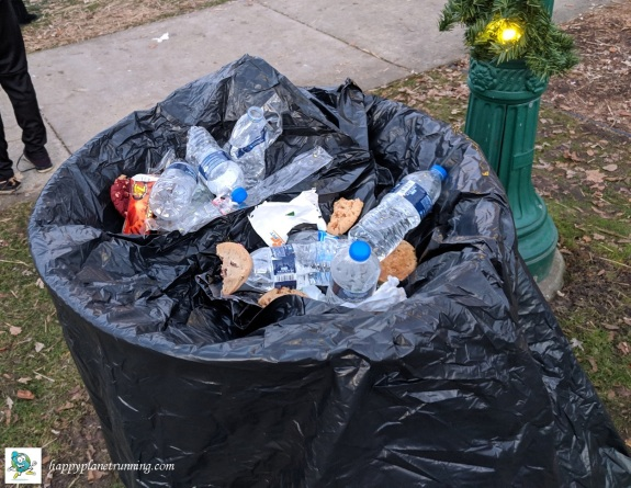 Holiday Hustle 2018 - Trash on top of covered bin