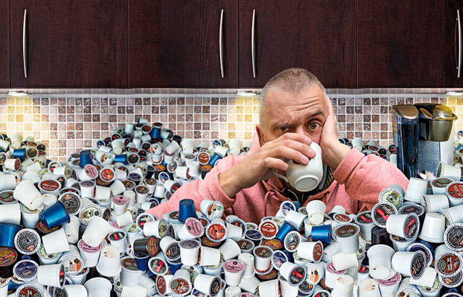 Photo of coffee drinker buried in K-Cups