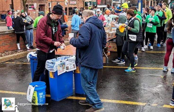 Shamrocks and Shenanigans 2019 - Scott helps person at station