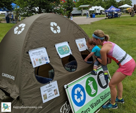 Canton Liberty Run 2019 - Mom helps toddler recycle