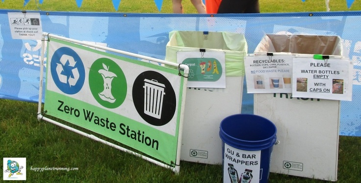 Island Lake Tri 2019 - Transition waste station with cleanup sign