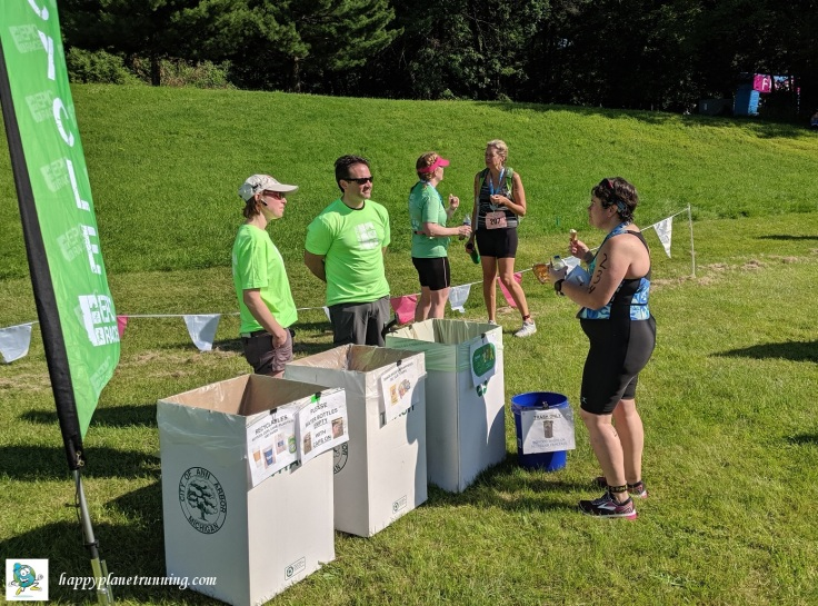 Tri Goddess Tri 2019 - Green Team talking with an athlete