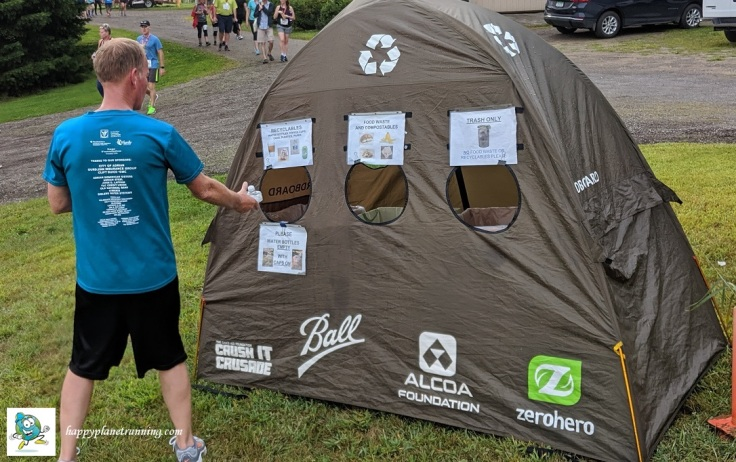 Vines 2019 - Runner looking at tent signage